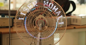 A persistence of vision display made with an ATMEGA32 dev board (microHOPE) and a table fan.
