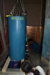tom working underneath the cryostat